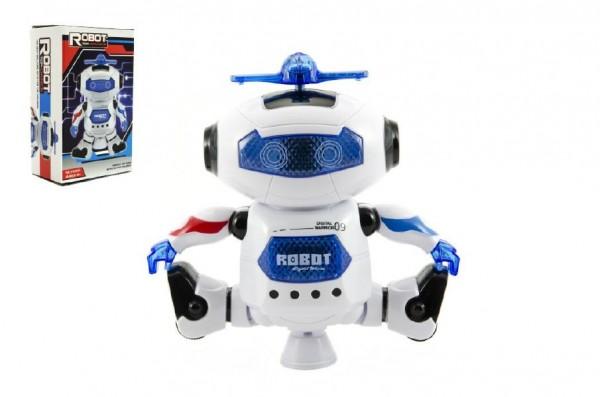 Robot tancující plast 15cm na baterie se světlem se zvukem v krabici 14x23x9cm