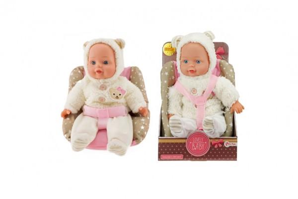 Panenka miminko v zimním oblečku měkké tělo v sedačce plast 30cm v krabici 19x30x15cm 24m+