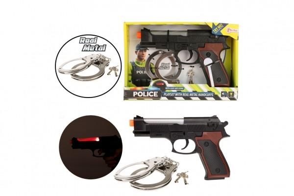 Policejní sada plast/kov pistole 21cm pouta s klíčkem na bat. se světlem se zvukem v krabici 26x17,5