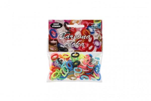 Céčka barevná 25g různé tvary plast v sáčku 10x11cm